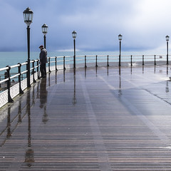After The Storm (Fourteenfoottiger) Tags: sea sky people storm man sunshine clouds reflections coast pier worthing seaside candid stormy lamppost