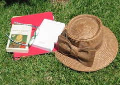 Vanishing! La Disparition. (Traveling with Simone) Tags: grass hat glasses outdoor books lunettes livres montaigne georgesperec