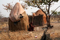 Himba village: Damaraland, Namibia (ronmcbride66) Tags: village huts plastic namibia himba mudhut stockade kamanjab mopanetree gascylinder semidesert mopane