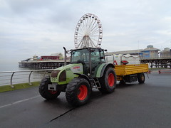 Claas Celtis 446 Tractor on Blackpool Promenade in front of the Big Wheel on Central Pier (j.a.sanderson) Tags: tractor wheel pier big central trailer blackpool celtis claas 446