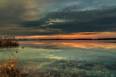 Icy wind (piotrekfil) Tags: sunset lake reflection ice nature water clouds landscape twilight pentax dusk poland waterscape piotrfil