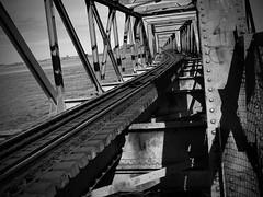 Tracks Over Sea (Paul NZL) Tags: bridge blackandwhite bw water monochrome train blackwhite bend harbour curves tracks rail railway monotone curve bandw bop tauranga bayofplenty mountmaunganui 10favorites 10faves