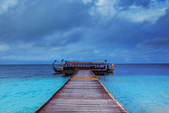 Maldivian Dhoni (-*HJS*-) Tags: ocean travel sea sky holiday water clouds canon landscape coast boat lowlight waves seascapes jetty tide tripod ngc indianocean tropical fullframe maldives luxury manfrotto dhoni 1635mm leefilters beacheslandscapes 5dmk2