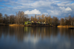 Static Sky (Moustafa Kzaiha) Tags: longexposure blue trees houses winter sky lake nature water colors clouds landscape daylight day cloudy sony le shore