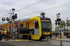 Rediscover Gold wrapped 1010 departing Azusa Downtown Station (Oran Viriyincy) Tags: train lacmta lrv kinkisharyo