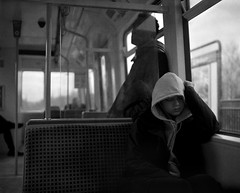 A Girl Sleeping on the Metro - South Shields (Richard James Palmer) Tags: street new uk portrait england urban blackandwhite white abstract black art 120 mamiya film girl monochrome train newcastle photography trapped shoot gloomy metro iso400 fineart north streetphotography documentary overcast rangefinder gritty ishootfilm tyne east iso ilfordhp5 400 walkabout epson hp5 medium format analogue asleep melancholy northern northeast ilford f4 isolated upon newcastleupontyne 1125 80mm tyneandwear 2015 v700 mamiya7ii microphen filmisnotdead 7ii ilfordmicrophen epsonperfectionv700