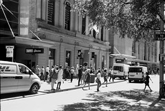 Pitt Street [Kodak Folding Brownie] (Aviator195) Tags: road street old city people blackandwhite building 120 film monochrome sepia buildings person grey cool interesting cityscape kodak candid sydney streetphotography australia monochromatic oldschool retro porta streetphoto kodachrome roads persons pitt scape streetscape woah 120mm greyscale filmscan 620film olden 620 filmphotography pittstreet filmphotos kodakbrownie cityofsydney porta400 120mmfilm filmphoto filmisnotdead foldingbrownie kodak620 kodakfoldingbrownie 620foldingbrownie