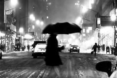 ManhattanBlur (wesbs) Tags: street city nyc newyorkcity winter people blackandwhite bw snow storm blur cars rain night lights streetlights manhattan nighttime winterstorm hss snowandrainmix streetblur sliderssunday happysliderssunday