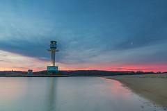 Rise of the Lighthouse (bhansen.kiel) Tags: red lighthouse beach nature clouds strand sunrise reflections germany landscape exposure natur wolken balticsea landschaft sonnenaufgang kiel falkenstein schleswigholstein