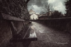 alone in a storm (cherryspicks) Tags: street wood sky storm art rain clouds buildings bench mood alone croatia atmosphere zagreb