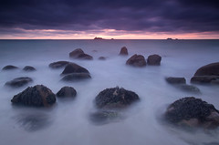 Purple Pain (Philippe Saire || Photography) Tags: ocean sunset sea sky mer seascape france beach nature water colors rock stone clouds canon landscape photography eos coast soleil photo sand brittany eau long exposure purple mark pierre couleurs iii horizon shoreline coucher violet sable bretagne wideangle playa cte breizh explore ciel shore 5d coastline usm fullframe nuages paysage plage ff ef 1740mm rocher jete hoya bzh finistre atlantique cokin nd400 littoral f4l plouarzel gnd4 p121m trzien ruscumunoc pleinformat philippesaire