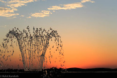 Fountain in the backdrop of sunset (Shot_At_Sight) Tags: sunset fountain waterdrops flowingwater fountainwithsunset