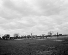 Flushing Meadows (Mattron) Tags: blackandwhite bw film field analog mediumformat landscape trix rangefinder flushingmeadows queens xtol mamiya7