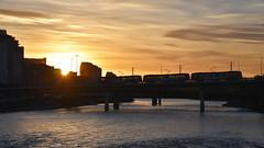 Sun setting in Calgary (blueshelfphoto) Tags: bridge sunset sun canada calgary clouds train river evening spring alberta bowriver yyc explorealberta