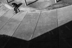 bracing (Matthew Almon Roth) Tags: street bw hat cane photography reading photo pattern shadows patterns cement carousel sidewalk elderly yerbabuenagardens frail childrenscreativitymuseum