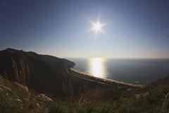 noon (pucciarellic) Tags: sea italy sun mountains reflection canon landscape eos italia mare fisheye 8mm montagna paesaggio sperlonga riflesso 600d