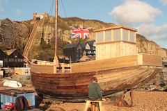 Boat repairs (colour) (Henry Hemming) Tags: fish beach sussex boat fishing fishermen craft hastings fleet trawler vessels