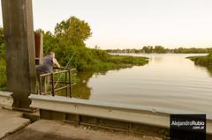 Fisherman in the bridge (.Alejandro Rubio.) Tags: sunset man argentina rio river atardecer fishing fisherman horizon ensenada hombre horizonte pescador caa pescando alerubio pezca
