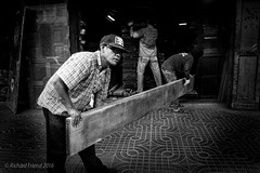 Wood Factory (Rich Friend) Tags: street wood people urban work thailand asia doors factory bangkok cities documentary labour dailylife weight everydaylife streetscenes hardwood reportage carpenter teak