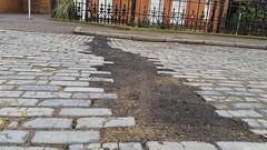 we want our cobblestones returned  in Stepney (Carol B London) Tags: road tarmac pavement stones roadworks digging replacement cobblestones cobbles e1 stepney londone1 dugup towerhamlets stepneygreen blueroad eyesores lbth cobblestoned diggingup btopenreach