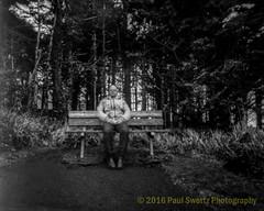 Pinhole Self Portrait (Paul Swortz) Tags: statepark blackandwhite bw lighthouse selfportrait monochrome bench oregoncoast 2016 ilforddelta100 swortz harmantitan