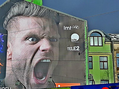 Simply frightening billboard. Riga, Latvia. February 22, 2016 (Aris Jansons) Tags: city building guy face europe capital baltic latvia billboard advertisement riga shouting frightening 2016 rga latvija