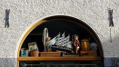 Junk? Treasure? (halifaxlight) Tags: window norway shop junk dolls treasure display bergen suitcase bricabrac containers brassinstrument modelboat