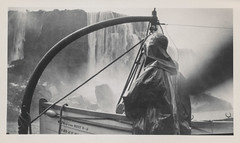 Man in a rain coat looking at Niagara Falls 2 (simpleinsomnia) Tags: old white black monochrome vintage found niagarafalls boat blackwhite waterfall ship antique coat snapshot tourist rubber niagara falls photograph vernacular waterproof slicker foundphotograph