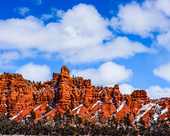 Bryce Canyon 1 (MarcCooper_1950) Tags: trees red sky orange snow colors clouds landscape utah nikon scenery rocks vivid canyon cliffs hills southern boulders hoodoo bryce rainfall hdr formations lightroom mounatins brycecanyonnationalpark geologic d810 marccooper
