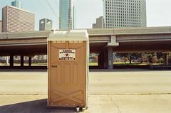 93060015 (alexdotbarber) Tags: slr film analog 35mm f11 portapotty kodakgold100 1125 downtownhouston colornegative olympusom2s olympusomzuiko28mmf35