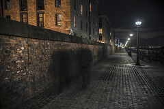 Walking the Chain mile (alun.disley@ntlworld.com) Tags: longexposure people art architecture night liverpool streetphotography brickwall cobbles blurredmotion rivermersey theroyalalbertdock