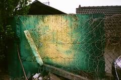 the wall (Nai.) Tags: green abandoned colors yellow wall rural 35mm 400 fujifilm pointandshoot filmcamera compactcamera xtra fujicolor filmphotography colornegativefilm 135film pentaxespiomini