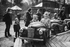 Baby you can drive my car (Explore 14/4/2016) (markfly1) Tags: white black monochrome car kids fun toy happy driving fair laughter