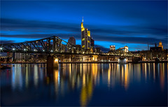 The Eiserner Steg bridge / Frankfurt 2016 (zilverbat.) Tags: city longexposure nightphotography bridge urban reflection skyline night skyscraper reflections germany dark de photography cityscape nightlights nightshot image availablelight frankfurt postcard main visit le stadt bluehour brug bild frankfurtammain afterdark duitsland brucke reflectie avondfotografie thefinancialdistrict zilverbat longexposurebynight photographybynight theeisernerstegbridge