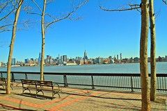 Bench With A View (pmarella) Tags: trees architecture fence bench manhattan promenade pmarella hudsonriver empirestatebuilding empirestate hoboken onthewaterfront riverviewpkproductions icoverthewaterfront