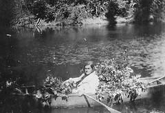 Granny (Jo-We Got Rain-Yippee!!!) Tags: old woman water outdoors photo bush woods canoe oar granny treebranches