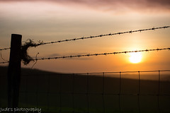 behind the wire the sun glows (judethedude73) Tags: light sunset england sky clouds downs landscape sussex skies colours dusk