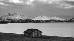 the deafening sound of silence (lunaryuna) Tags: winter bw panorama mountains cold abandoned monochrome norway season landscape blackwhite solitude mood hut silence lunaryuna hibernation northernnorway tromsfylke arcticregion lyngenalps seasonalwonders fjordullsfjorden