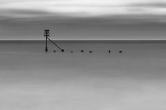 Stranded (Number Johnny 5) Tags: sea bw white seascape black beach seaside nikon long exposure noir minimal d750 tamron groyne minimalist gorleston 2470mm