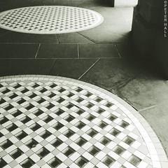 Cropped Circles (peterphotographic) Tags: city uk shadow england urban building london apple monochrome circle square floor britain pavement mosaic trafalgarsquare column 4s waterstones iphone camerabag2 croppedcircles peterhall 20160201104413sqcb2downtownedwm