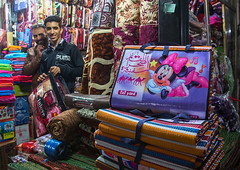 vendors in the bazaar with minnie mouse logos on blankets, Hormozgan, Bandar Abbas, Iran (Eric Lafforgue) Tags: people usa men shop horizontal america photography persian store asia iran market middleeast fake persia disney business indoors trading blanket vendor bazaar blankets minniemouse trade 2people twopeople seller adultsonly middleeastern waltdisney persiangulf bandarabbas menonly youngadultman hormozgan  bandari   iro straitofhormuz  colourpicture  iran034i1682