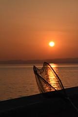 Red sky (norella.giorgia) Tags: sunset red sky italy sun lake reflection net harbor reflex twilight fishing garda tramonto reflected porto pesca lagodigarda riflesso retino gardaslake