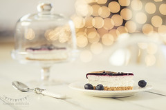 Breakfast (Ramn Antiolo) Tags: christmas xmas light stilllife white kitchen glass cake glitter bulb cheese breakfast vintage pie table dessert wooden cozy berry shiny glow shine bell bokeh lifestyle spoon cheesecake garland retro safety blueberry cover dome jar shield safe transparent dairy tart isolated blueberries cloche protect belljar huckleberry bilberry shabbychic instagram