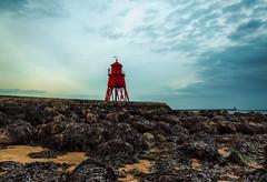 Groyne at low tide (munkehmans) Tags: sunset sun lighthouse seaweed beach rock river coast town seaside transport tyne coastline northern northeast southshields tyneside littlehaven groyne rivertyne tyneandwear southtyneside northeastengland littlehavenbeach herdgroyne