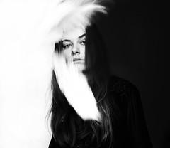 Hidden (lunarlaro) Tags: portrait blackandwhite woman white black hair autoportrait emotion feeling