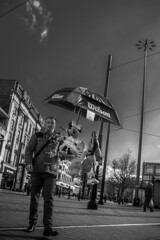 It's raining inflatables (tootdood) Tags: street blackandwhite umbrella manchester piccadilly vendor raining brolly inflatables streetcandid canon70d