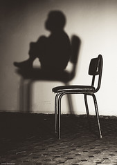 I'm Here (Jamal Benamer) Tags: shadow blackandwhite bw art canon dark sitting loneliness darkness fear worried 1855mm conceptual stress sorrow darkart 450d