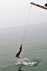 Making a splash (Roving I) Tags: sea playing vertical fun action jetty teens vietnam beaches ropes swinging danang splashing sontra