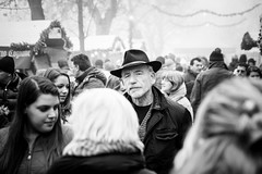 The man with the hat (gviarizzo) Tags: christmas street people blackandwhite bw italy holiday man senior hat festival market crowd streetphotography oldman christmasmarket noel fest onthestreet mustaches mercatini manwithhat