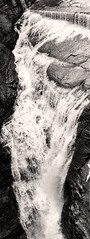 Steep Drop at the Upper Falls (LJS74) Tags: blackandwhite bw monochrome waterfalls newyorkstate fingerlakes verticalpanorama upperfalls taughannockfalls stitchedpanorama